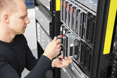 It consultant install blade server in datacenter Stock Photos