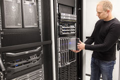 IT Consultant install blade server in large datacenter Royalty Free Stock Photos