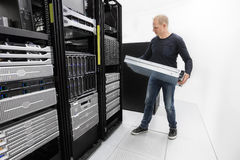 It consultant install rack server in datacenter Stock Photos