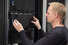 It consultant installing server in datacenter Stock Image