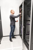 IT consultant installs network rack in datacenter Royalty Free Stock Photography