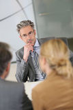 Consultant listening to clients during meeting Stock Photos