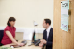 Consultant Meeting With Patient In Office Stock Image