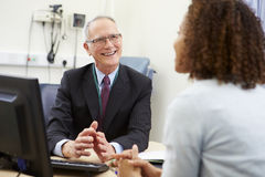 Consultant Meeting With Patient In Office Royalty Free Stock Images
