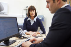 Consultant Meeting With Patient In Office Royalty Free Stock Photo