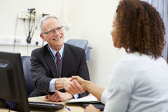 Consultant Meeting With Patient In Office Royalty Free Stock Image
