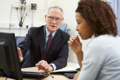 Consultant Meeting With Patient In Office Stock Photos