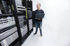 It consultant monitor servers in data center Royalty Free Stock Photos