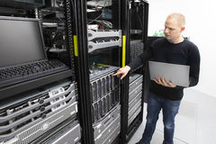 It consultant monitors blade servers in datacenter Royalty Free Stock Images