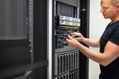 IT Consultant Monitors Servers In Data Center Stock Image
