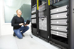 It consultant monitors servers in datacenter Stock Photography