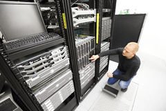 It consultant monitors servers in datacenter Royalty Free Stock Image