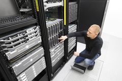 It consultant monitors servers in datacenter Royalty Free Stock Photography
