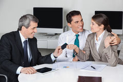 Consultant offering business card Royalty Free Stock Photos