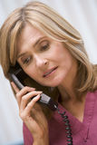 Consultant phoning client with bad news. Consultant phoning client from surgery with bad news Royalty Free Stock Photography