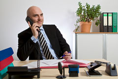 Consultant phoning with customers Stock Photos