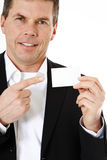 Consultant pointing at blank business card Stock Image