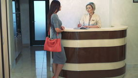 Consultant recorded the client on admission to the beautician. In full HD stock footage