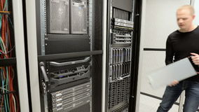 IT consultant removes blade server in datacenter stock video