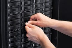IT Consultant Replace Hard Drive in SAN Stock Photo