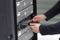 IT Consultant Replace a Harddrive in Server Royalty Free Stock Photography
