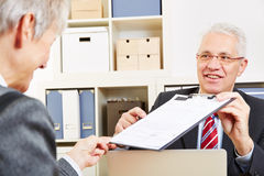 Consultant showing minutes Stock Image