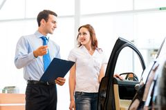 Consultant in the showroom and the buyer Stock Photo