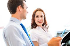 Consultant in the showroom and the buyer Stock Photography