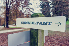 Consultant signpost with right pointing arrow Stock Image