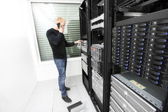 IT consultant solving problem with support in datacenter Stock Images
