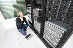 IT consultant solving problem with support in datacenter. It engineer or technician monitors and solving problems with servers and network equipments in data Royalty Free Stock Image