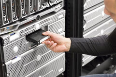 It consultant work with backup in datacenter. It engineer or consultant working with backup server in racks. Shot in data center Stock Images