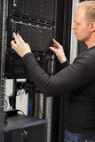 It consultant working with installation of a server in datacenter Royalty Free Stock Photo