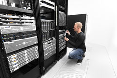 It consultant working with SAN in datacenter Royalty Free Stock Images