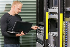 It consultant working with servers Stock Image