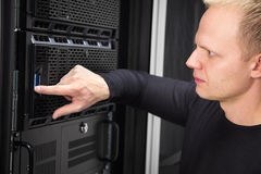 It consultant working with servers in enterprise datacenter Stock Image
