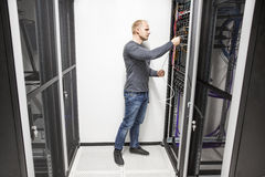 IT consultant works with network in datacenter Stock Photography