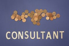 Consultant written with wooden letters on a blue background. To mean a business concept Royalty Free Stock Images