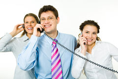 Consultants. Group of smiling consultants speaking on their phones on white background with man between women Stock Photography