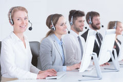 Consultants wearing headphones. Professional consultants wearing headphones and using computers Stock Photography