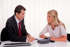 Consultation. Husband and wife in a consultation. Business talk royalty free stock images