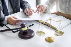 Consultation and conference of professional businesswoman and Male lawyers working and discussion having at law firm in office. Concepts of law, Judge gavel stock photo