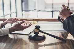 Consultation and conference of professional businesswoman and Male lawyers working and discussion having at law firm in office. Concepts of law, Judge gavel stock image