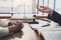 Consultation and conference of professional businesswoman and Male lawyers working and discussion having at law firm in office. stock photo