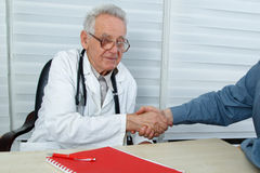 After consultation doctor and patient shake hands Stock Photography
