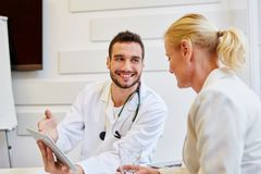 Consultation with doctor and senior patient. Talking about therapy advice royalty free stock photos