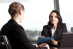 Consultation with financial adviser. Consultation with female financial adviser in a nice office Stock Photography