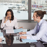 Consultation with financial adviser. Consultation with female financial adviser in a nice office while drinking water Royalty Free Stock Photo