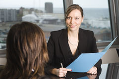 Consultation with insurance agent. Insurance agent with client in a nice office Royalty Free Stock Photo