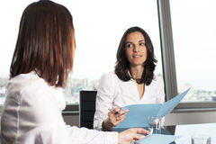Consultation with insurance agent. Insurance agent with client in a nice office Royalty Free Stock Image